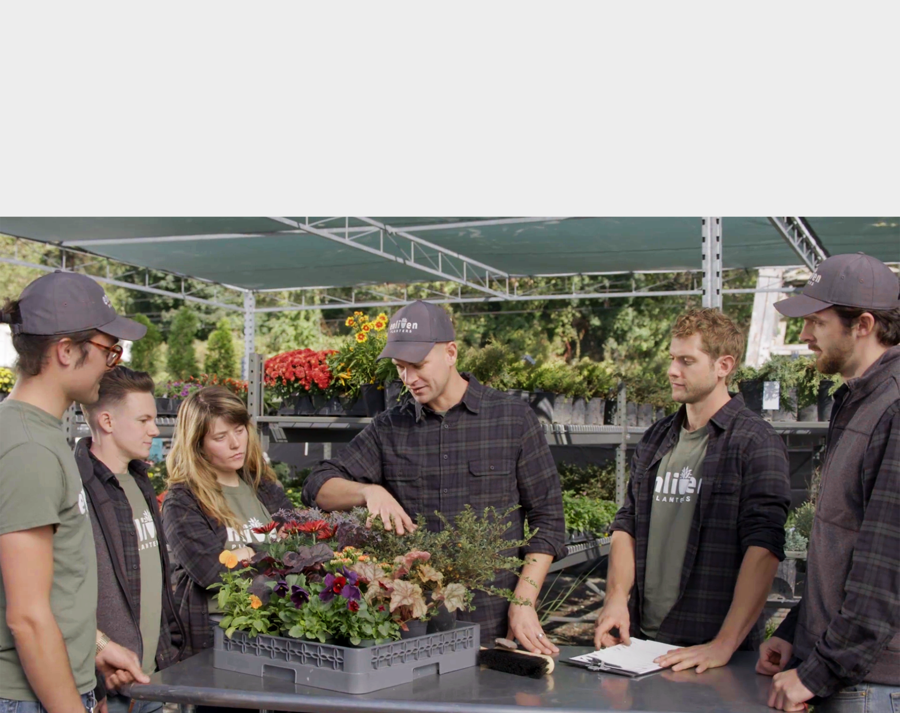 Enliven staff members discussing the season's plant selections