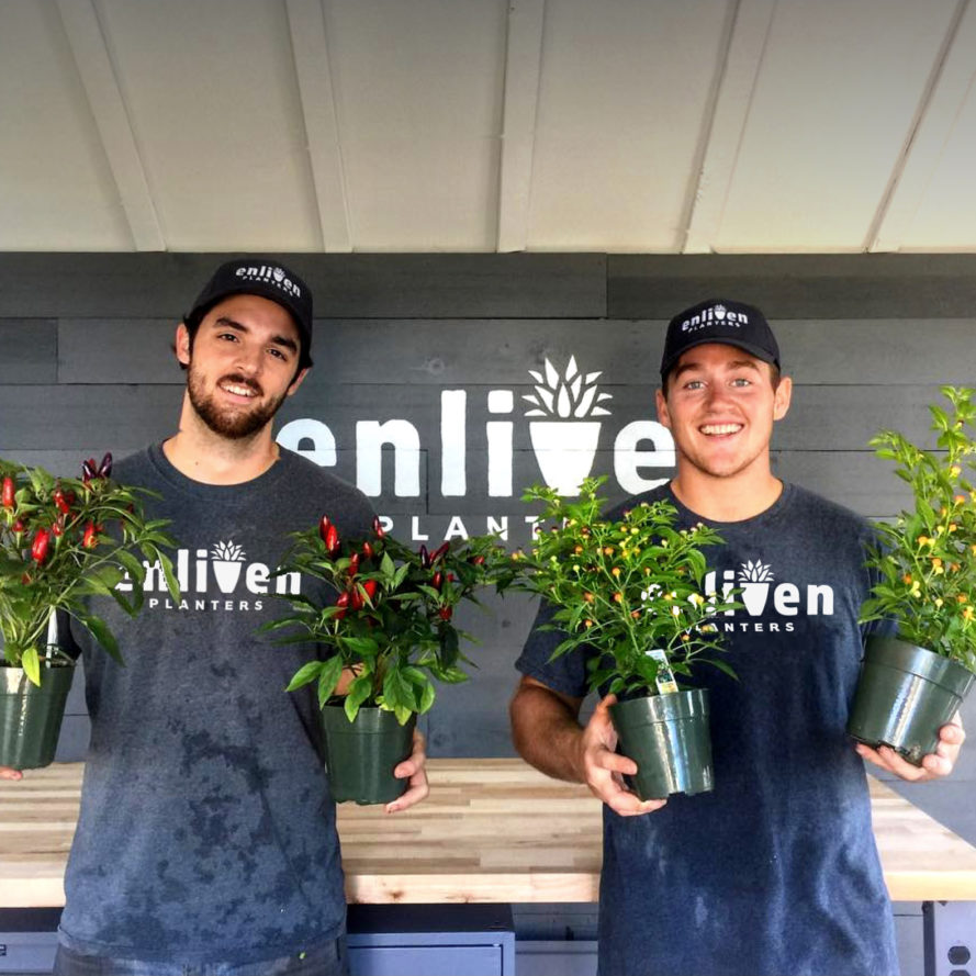 Employees holding new plants for season's arrangements.