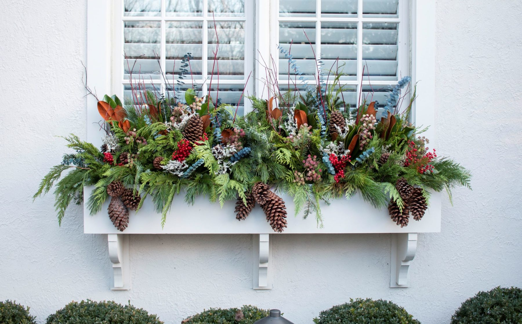 Winter Window Box Arrangement with Green Pine and Pinecones